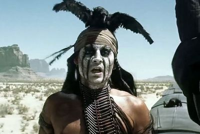 """Johnny Depp's character of the Native American sidekick Tonto in <i>The Lone Ranger</i> couldn't have been more forced if he tried.<br/><br/><i>Us Weekly</i> critic Mara Reinstein nailed it in her review: """"Depp has done the kooky, costumed character shtick so many times, it's no longer surprising to see him bury his index finger into the desert sand, then lick it.""""<br/><br/><b>Weird factor: 9/10</b>"""