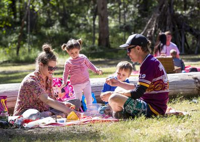 A family enjoys a picnic at Daisy Hill Forest Park in Brisbane, Saturday, May 2, 2020.