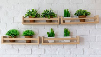 The key to making faux plants work as stylish décor