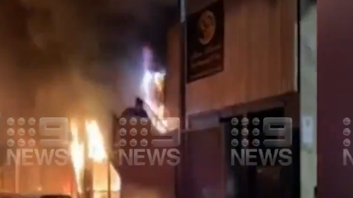 Woman runs down stairwell as building burns in Adelaide