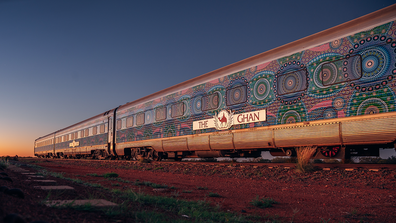 The Ghan artwork at sunset
