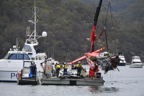 The mangled Sydney Seaplanes craft was pulled from the water in the days after the crash. (AAP)