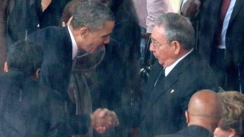 US President Barack Obama shakes hands with his Cuban counterpart Raul Castro at Nelson Mandela's memorial in December 2013. (Getty)