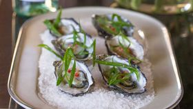 Freshly shucked Sydney rock oysters with lemongrass, chilli and shallot dressing
