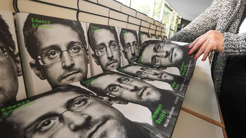 "Copies of Edward Snowden's new book ""Permanent Record"" are displayed for sale during a live broadcast with the US journalist and whistleblower streamed at the the Urania Berlin."