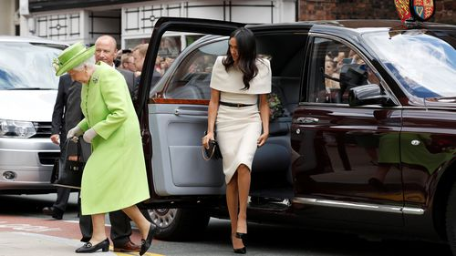 Meghan wasn't sure if she should get in the car ahead of the Queen, but the Queen quickly guided her through the correct protocol. Picture: Getty