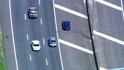 At times, the pursued car avoided traffic by driving over median strips. (9NEWS)