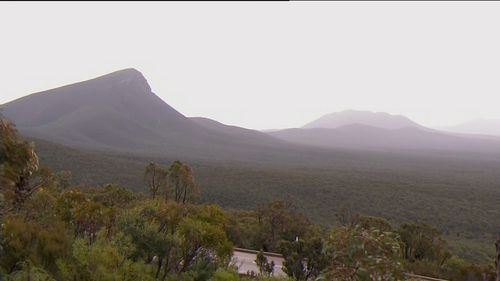 The man trekked to the top of Bluff Knoll to look at the snow.
