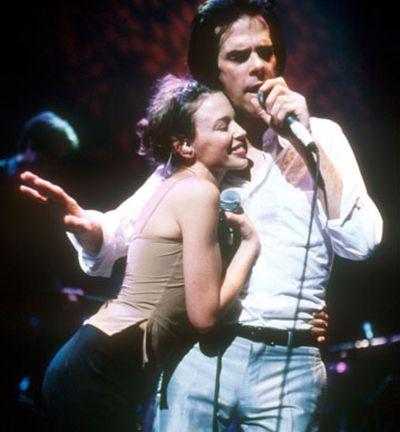 Nick Cave And Kylie Minogue performing at Royal Festival Hall, London. May 20, 1997.