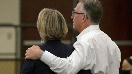 In this June 29, 2020, file photo, Gay and Bob Hardwick, who were attacked in their Stockton home in 1978 by the Golden State Killer, Joseph James DeAngelo, stand as the charges are read against DeAngelo during a hearing in Sacramento, Calif. Survivors plan to confront DeAngelo this week during an extraordinary four days of court hearings before the 74-year-old is sentenced to life in prison. (AP Photo/Rich Pedroncelli, File)