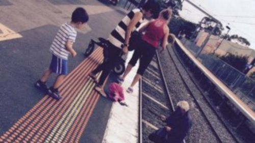 Commuters rescue toddler from train tracks in Melbourne