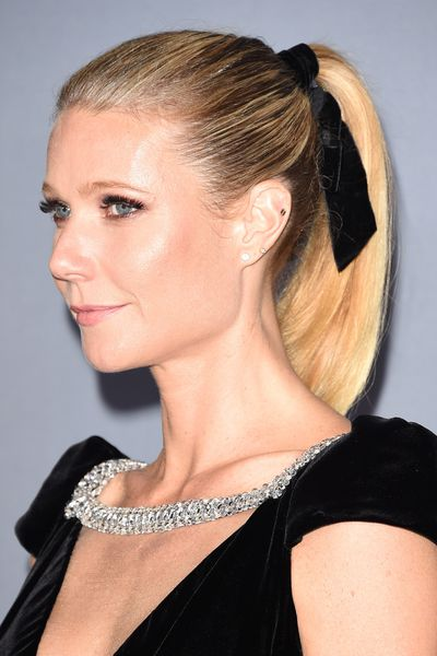 Elevate a ponytail by adding a ribbon.