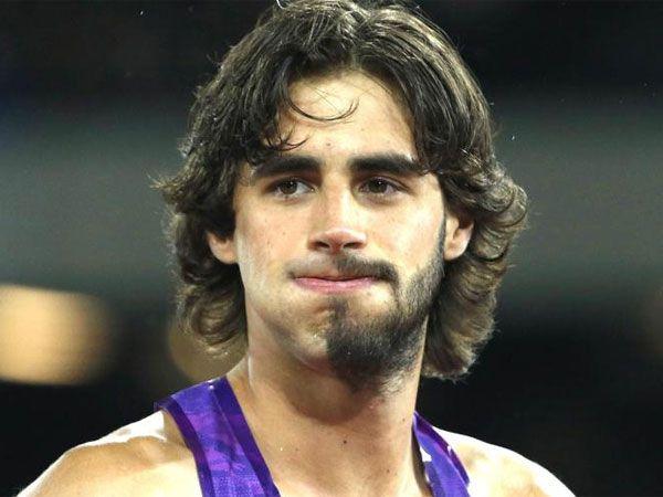 High jumper sports weird half beard