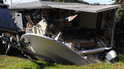 Florida is notorious for sinkholes, with this one threatening to swallow an entire house and a boat in November 2013. (Getty)