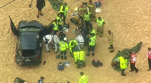 An elderly woman was thrown from the vehicle and a man, believed to be her husband, was trapped for over an hour.
