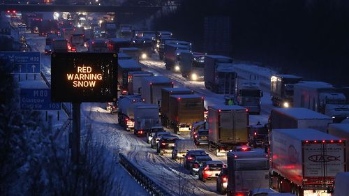 The scene on the M80 Haggs in Glasgow, as the highest level of weather warning has been issued for Scotland and Ireland as forecasters warn of blizzard-like conditions. (AAP)