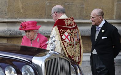 Britain's Queen Elizabeth II, left, and Prince Philip leave the chapel after the wedding of Lady Gabriella Windsor and Thomas Kingston at St George's Chapel, Windsor Castle.