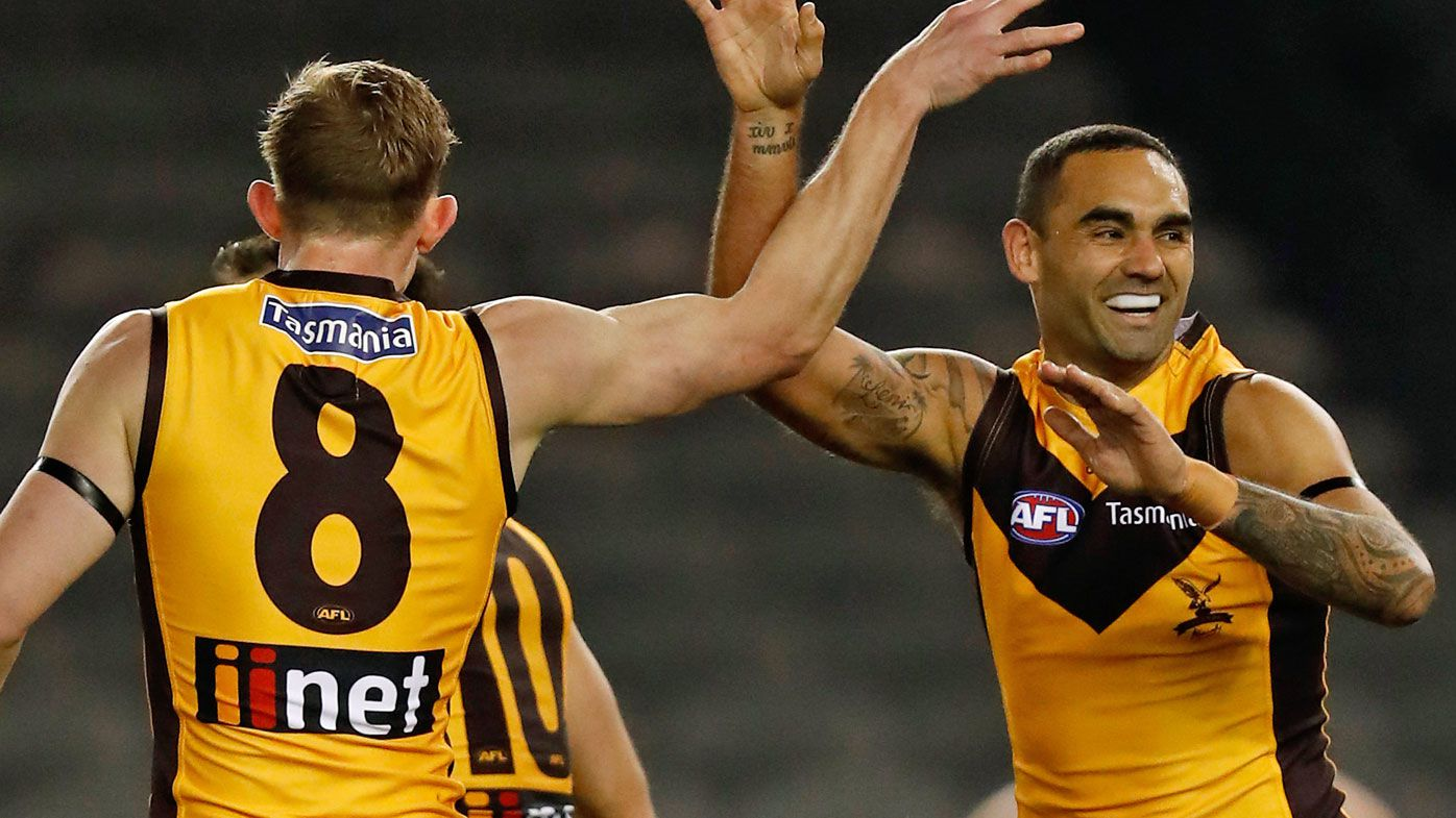 Shaun Burgoyne of the Hawks celebrates a goal