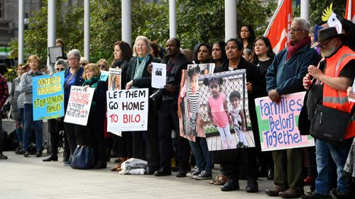 Supporters of the Biloela Tamil asylum seeker family gather outside of the Federal Court in Melbourne.