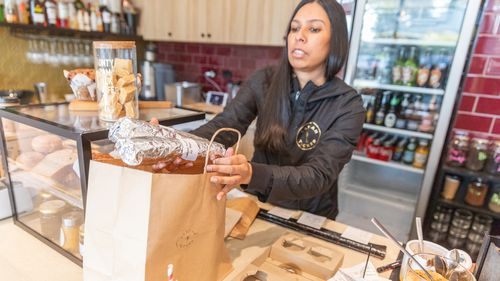 Nerissa Jayasingha owner of cafe Lankan Tucker packing a take away order on July 09, 2020 in Melbourne, Australia.
