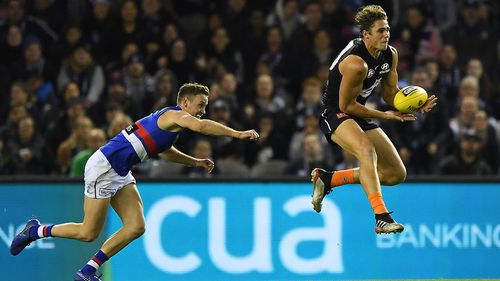 Charlie Curnow led a furious Carlton comeback with a career-best seven goals.