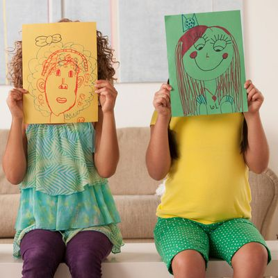 Children holding up drawings