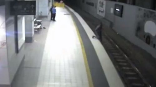 The intoxicated man could be seen stumbling onto the tracks. (9NEWS)