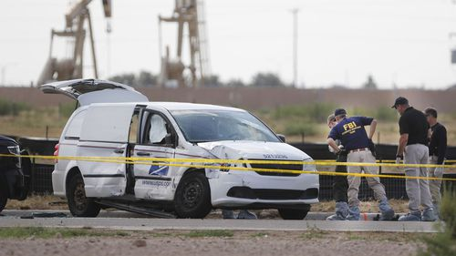 The mail van the gunman hijacked before killing Ms Granado and going on his shooting spree.