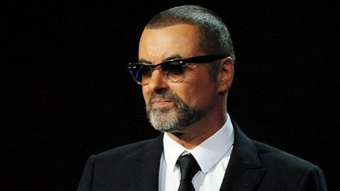 George Michael presents at the BRIT Awards 2012.