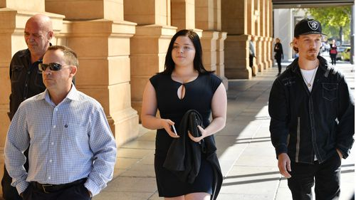 Family members of victims Sherril Pountney and Patricia Phillips are seen outside Adelaide Supreme Court today. (AAP)