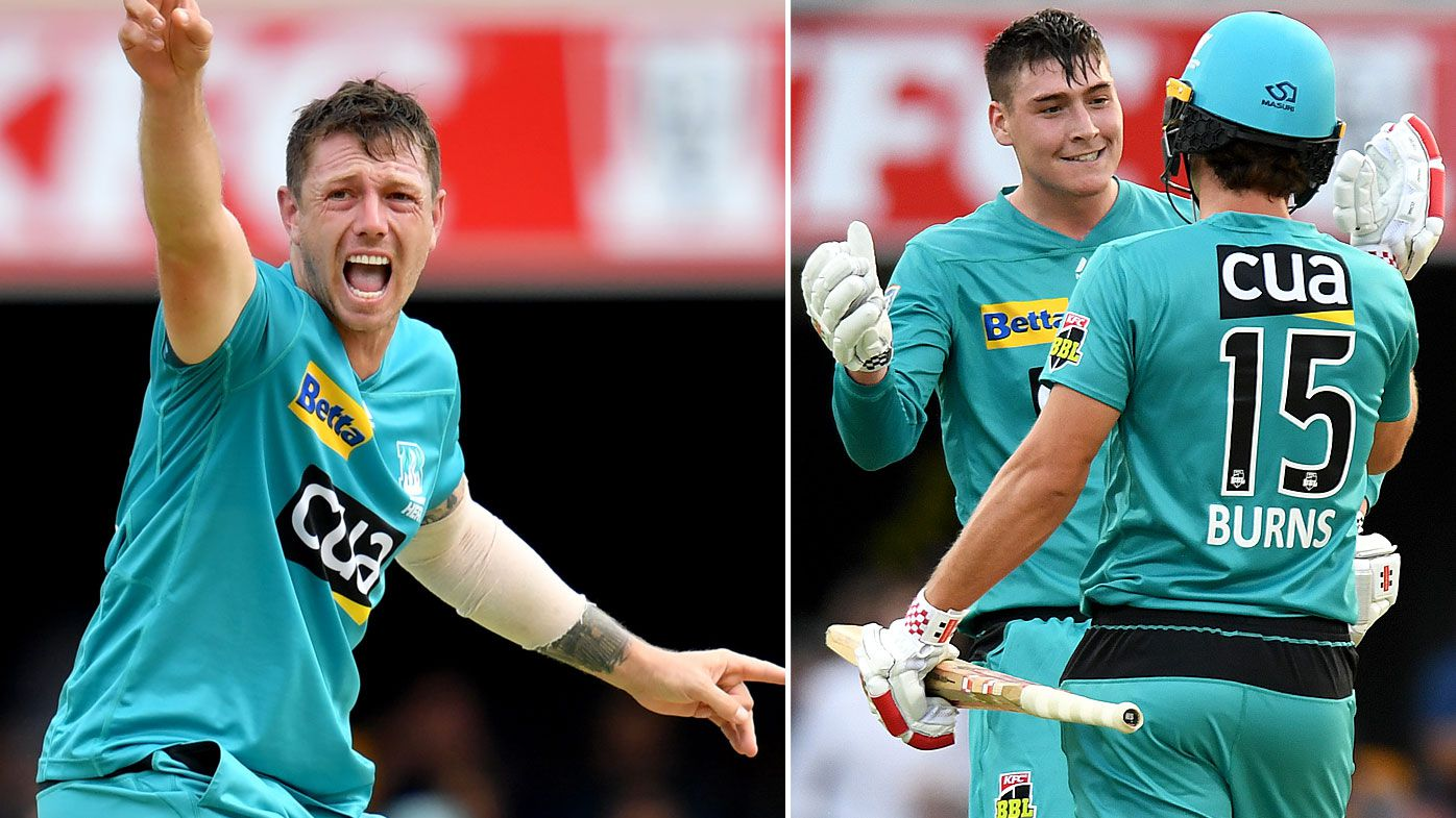 Matthew Renshaw and Joe Burns of the Heat celebrate victory after winning the Big Bash League