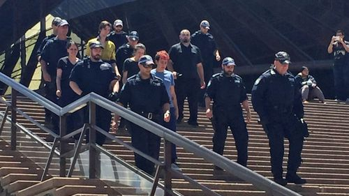Five climbers scaled the Sydney Opera House to protest the treatment of refugees on Manus Island on Thursday. (9NEWS)