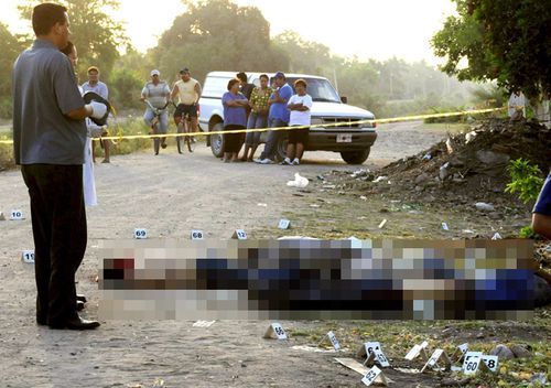 Mexican Police at a crime scene where five dead people were found, believed killed by the Sinaloa cartel.