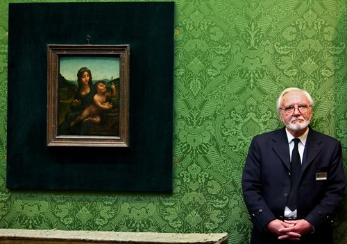Joe Hay, security guard at the National Gallery of Scotland, stands beside the Leonardo da Vinci painting 'Madonna Of The Yarnwinder' on March 1, 2010 in Edinburgh, Scotland. (Getty)