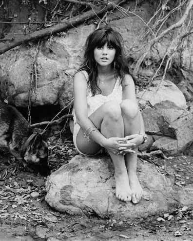 Singer Linda Ronstadt poses for a portrait for her first solo album 'Hand Sown... Home Grown' on March 1, 1968 in Topanga, California