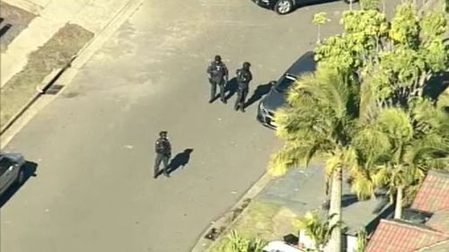 Officers outside the home. (9NEWS)