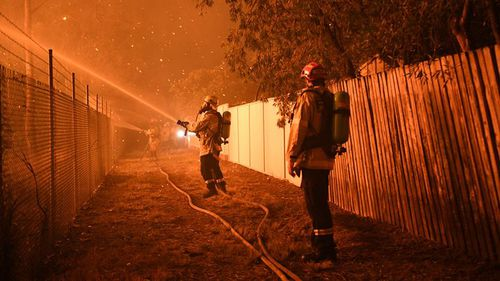 Embers posed a serious threat to homes on Saturday night. (AAP)