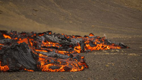 Lava flows from a new fissure on a volcano on the Reykjanes Peninsula in southwestern Iceland.