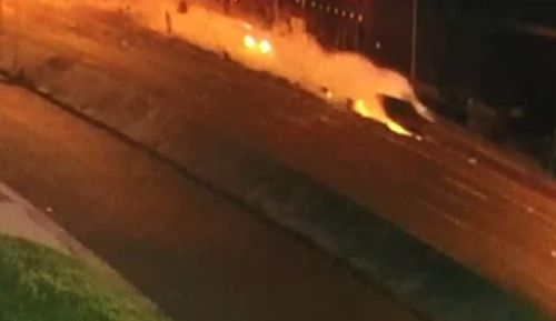CCTV shows the moment the out-of-control car slammed into the pole.