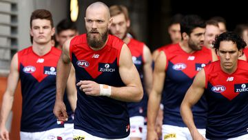 Max Gawn of the Demons leads his team out during the round 7