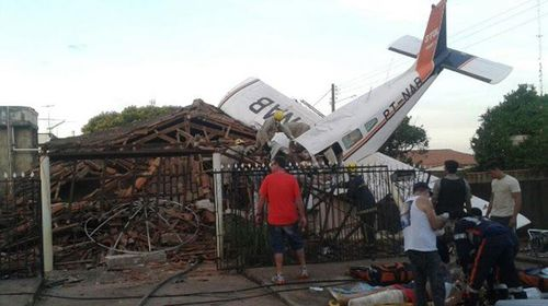 Plane crashed onto house, kills two