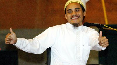 <p><b>The Smiling Assassin: Amrozi Nurhasyim </b></p> Receiving his nickname from his nonchalant demeanour in court, Amrozi was reportedly motivated by his hatred of US foreign policy, and the seemingly decadent behaviour of Australians on holiday in Bali. Upon his arrest, Amrozi admitted to playing a role in the attacks, and admitted to three other bombings. He was executed by firing squad alongside his brother, Mukhlas, and Imam Samudra in 2003