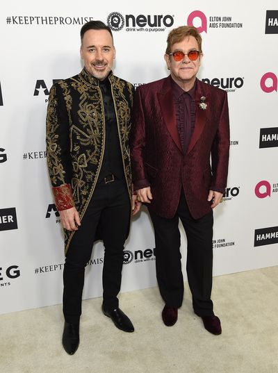 Birthday boy Elton John and husband David Furnish did not disappoint in loud jackets.
