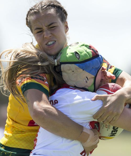 Isabelle Kelly lays a tackle during the win over England. (AAP)