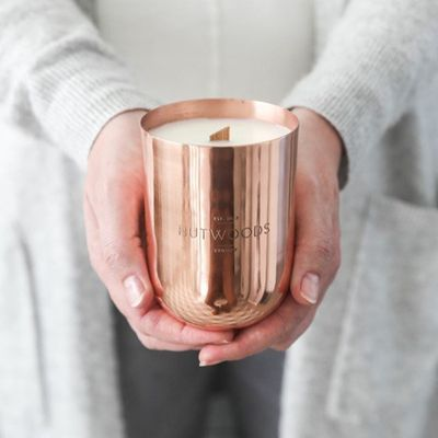 "<a href=""https://www.hutwoods.com.au/collections/luxury-range"" target=""_blank"" draggable=""false"">Hutwood Luxury Candle in Copper Vessel, $69.95.</a>"