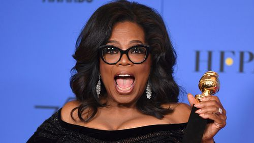 Oprah Winfrey poses in the press room with the Cecil B. DeMille Award at the 75th annual Golden Globe Awards. (AAP)