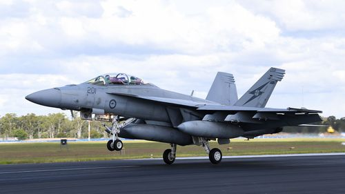 Jet fighter forced to make emergency landing at Brisbane Airport