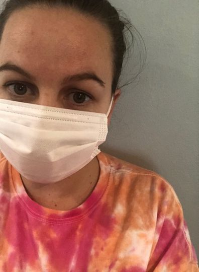 Sydney woman tested for COVID-19 after becoming sick overseas.