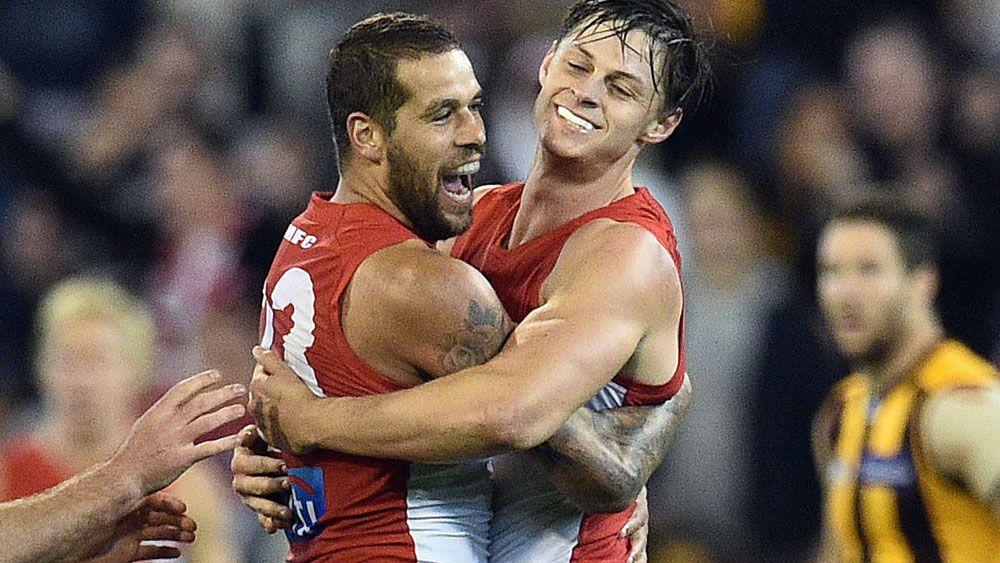 Swans score emotional AFL win over Hawks