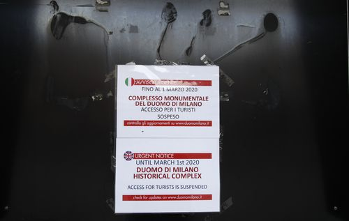 A sign indicates the closure for tourists of the historical complex of Milan's Duomo until March 1, in Milan, northern Italy, Wednesday, Feb. 26, 2020. Picture: Antonio Calanni